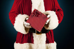 Santa: Holding a Wrapped Present Royalty Free Stock Photos