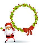 Santa Holding Wreath Royalty Free Stock Image