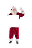 Santa holds a sign and is waving Royalty Free Stock Photos