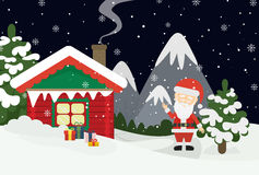 Santa at home. Beautiful scene of Santa Claus near christmas house in snow. Dark sky with stars. Winter landscape with mountains and snow Royalty Free Stock Image