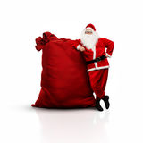 Santa with huge sack isolated on white Royalty Free Stock Photos