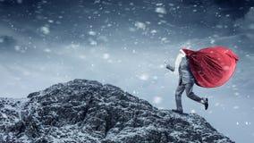 Santa is hurrying up. Mixed media royalty free stock image