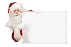 Santa indiquant le panneau blanc Images libres de droits