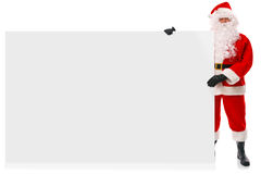 Santa intégrale retenant le grand signe blanc Images libres de droits