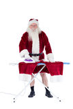 Santa is ironing his pants Stock Image