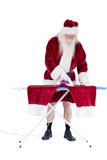 Santa is ironing his pants Royalty Free Stock Photo