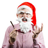 Santa irritada com lâmina Foto de Stock Royalty Free