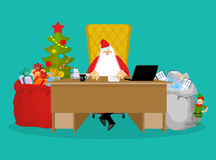 Santa job. Claus checks mail from children. Big bag of incoming Royalty Free Stock Images