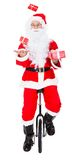 Santa juggling on monocycle Royalty Free Stock Image