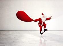 Santa jumping with skateboard Stock Photo