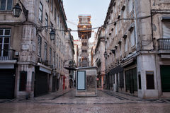 Santa Justa Lift in Lisbon. Santa Justa Lift (Portuguese: Elevador de Santa Justa) in Lisbon, Portugal and an old apartment houses in Baixa part of the city Stock Images