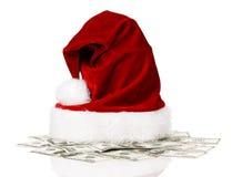 Santa kapelusz na dolarach Zdjęcia Royalty Free