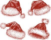 Santa kapelusze Zdjęcia Royalty Free