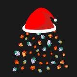 Santa kapeluszu deszcz prezenty Prezenta opad śniegu Bożenarodzeniowa czerwona nakrętka Obraz Stock