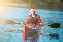 Santa kayaking stock image