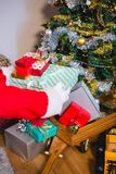 Santa keeping gifts on wooden trolley. Close-up of santa keeping gifts on wooden trolley Royalty Free Stock Image