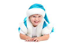 Santa Kid-het iying op vloer en het glimlachen royalty-vrije stock afbeelding