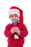 Santa kid playing with his cap stock images