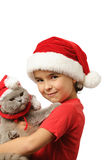 Santa kid with Santa cat Royalty Free Stock Image