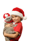 Santa kid with Santa cat Royalty Free Stock Photo