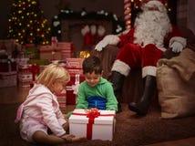 Santa with kids Stock Photos