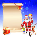 Santa with kids and a big sign Royalty Free Stock Photo