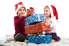 Santa kids enjoying Christmas presents  Stock Photos