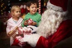Santa with kids Stock Photo