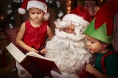 Santa with kids Royalty Free Stock Photos