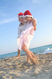 Santa kids at the summer beach Stock Photos