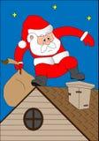 Santa Klaus em um telhado da casa Foto de Stock