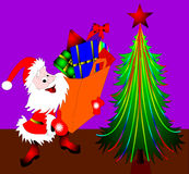 Santa Klaus beside fir trees Stock Photo