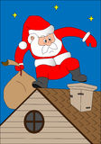 Santa Klaus on a house roof. Climbs in a pipe Stock Photo