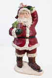 Santa Klaus. Old fashioned handmade statuette of Santa Klaus on isolated background Stock Images