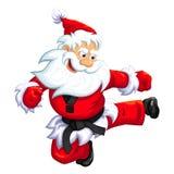 Santa Klaus sautent le coup-de-pied Photographie stock libre de droits