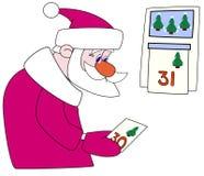 Santa-klaus tears off a calendar leaf Royalty Free Stock Images