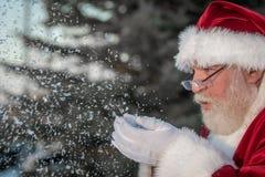 Santa klauzula podmuchowy śnieg Zdjęcia Stock