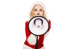 Santa kobieta krzyczy megafonem Zdjęcia Royalty Free