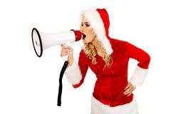 Santa kobieta krzyczy megafonem Fotografia Royalty Free