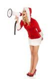 Santa kobieta krzyczy megafonem Obrazy Royalty Free