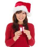 Santa kobiety mienia bożych narodzeń kapeluszowy Bożenarodzeniowy prezent Zdjęcie Royalty Free