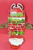Santa komin i babeczka Fotografia Stock