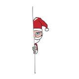 Santa kryjówka za ściennym kreskówka rysunkiem Fotografia Stock