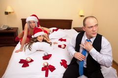 Santa ladies waiting their boss in bed Royalty Free Stock Images