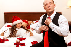 Santa lady is waiting her boss in bed Royalty Free Stock Photos