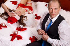 Santa lady is waiting her boss in bed Royalty Free Stock Photography