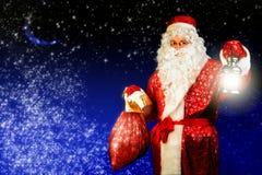 Santa with lamp Royalty Free Stock Photo
