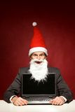 Santa with laptop Stock Image