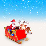 Santa with laptop and reindeers Stock Photography