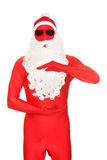 Santa in latex clothing holding copyspace Royalty Free Stock Photos